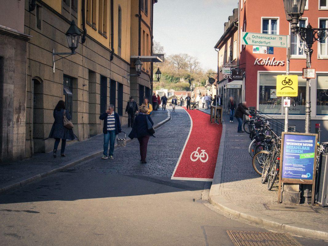 Ein sichtbarer Radweg auf der Alten Mainbrücke? Fotomontage: Dominik Ziegler