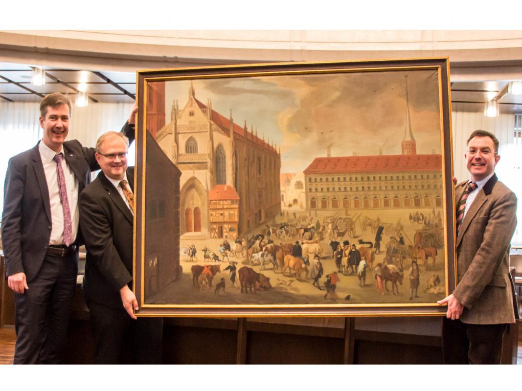 Das Gemälde mit v.l.n.r.: Oberbürgermeister Christian Schuchardt, Bernd Rosengarth und Kämmerer Robert Scheller. Foto: Claudia Lother