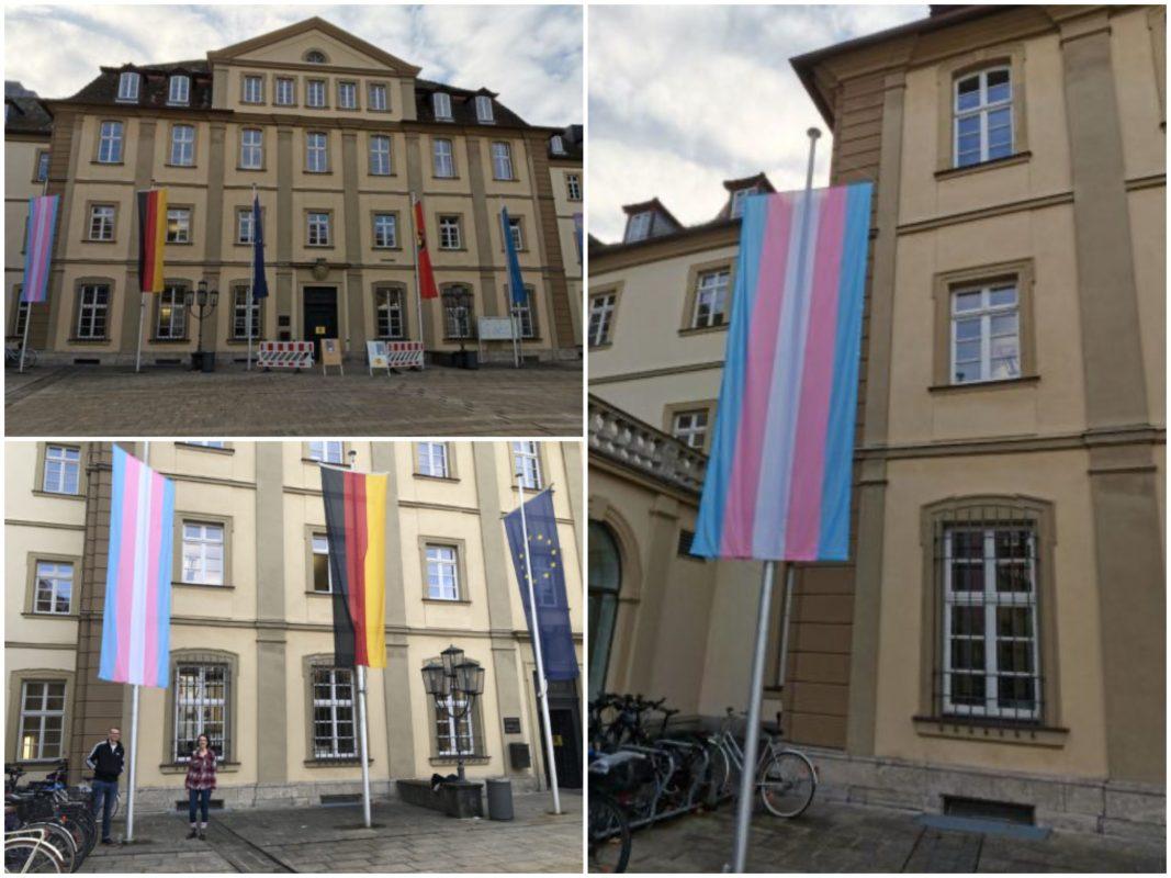 Die Flagge der trans Community vor dem Rathaus / Grünen Stadträte Magdalena Laie und Konstantin Mack. Fotos. Grüne Jugend Würzburg
